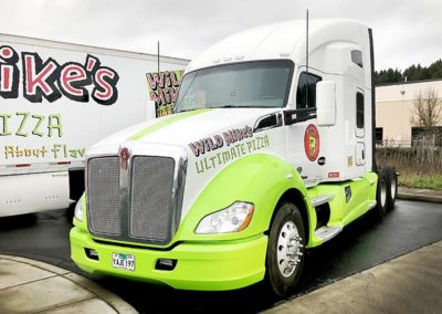 Cascade Wraps Wild Mikes Pizza cab has a bright green stripe down the hood